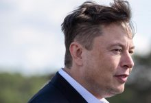 In this September 3, 2020, file photo, Tesla head Elon Musk arrives to have a look at the construction site of the new Tesla Gigafactory near Berlin.